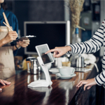 paying for coffee on a tablet